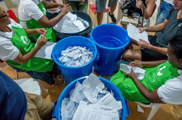 Shredding paper is the first step to recycling it. This impact activity is just one of many available on a Fathom cruise to the Dominican Republic.