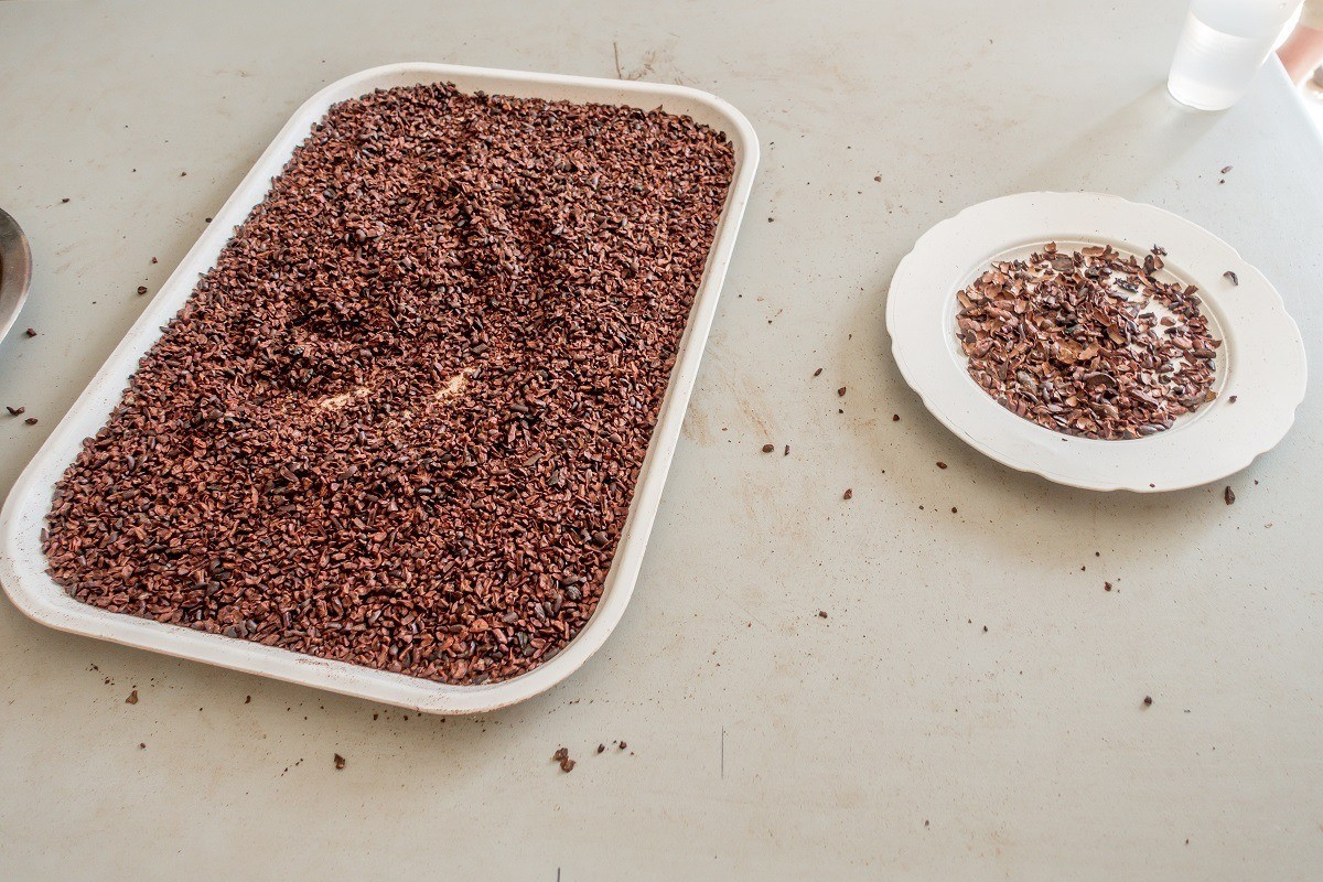 Platter of cocoa nibs next to a plate of removed shells