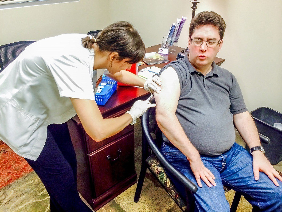 Man getting immunizations