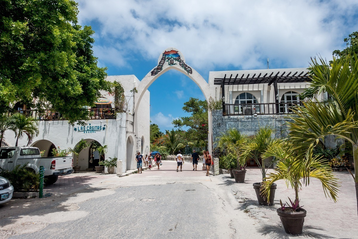 The main entrance gate to Akumal, Mexico. Head through the gate to the Akumal snorkeling paradise!
