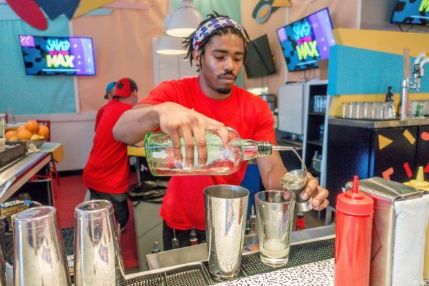 Bartender at Saved by the Max making drinks with names inspired by the cast of Saved by the Bell