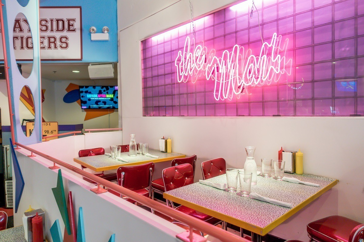 Tables and sign at Saved by the Max pop-up restaurant
