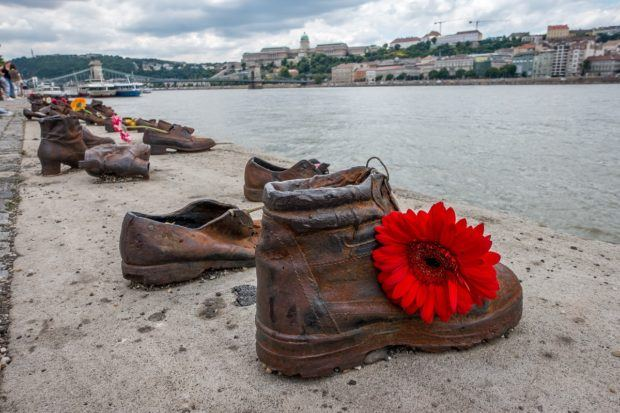 Visitors often leave flowers at Shoes on the Danube in tribute to the victims of the Holocaust