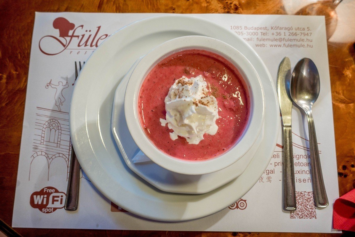 Cold fruit soup topped with whipped cream