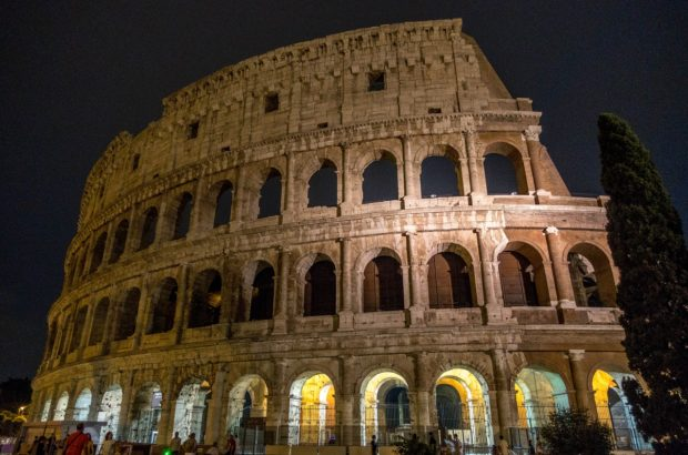 Rome's Colosseum lit up at night. A night tour lets you visit exclusive parts of the ancient building.