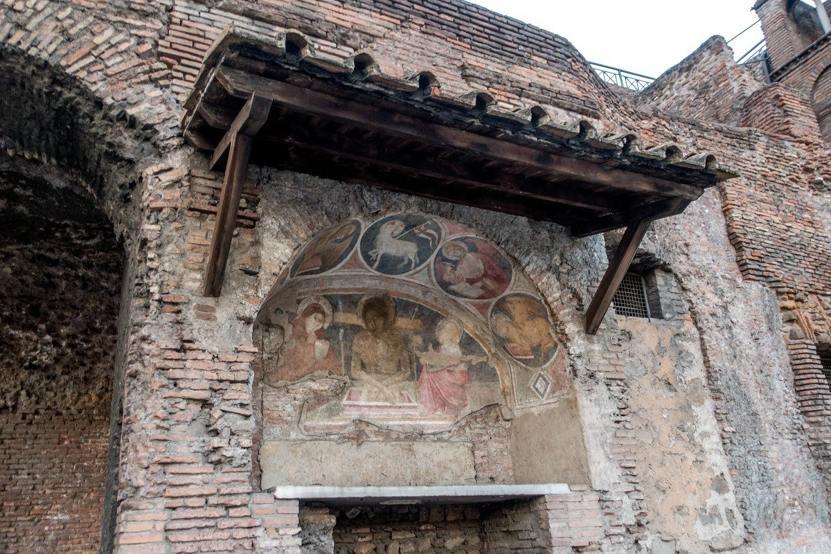 Early Christian art outside on a brick wall in Rome