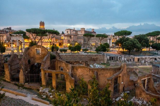 Roman ruins, including the beautifully-lit Trajan's market, are stops on a Colosseum night tour