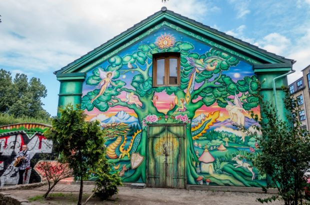 The entrance to Freetown Christiania in Copenhage, Denmark. This is just one of many colorful murals in the walled community.