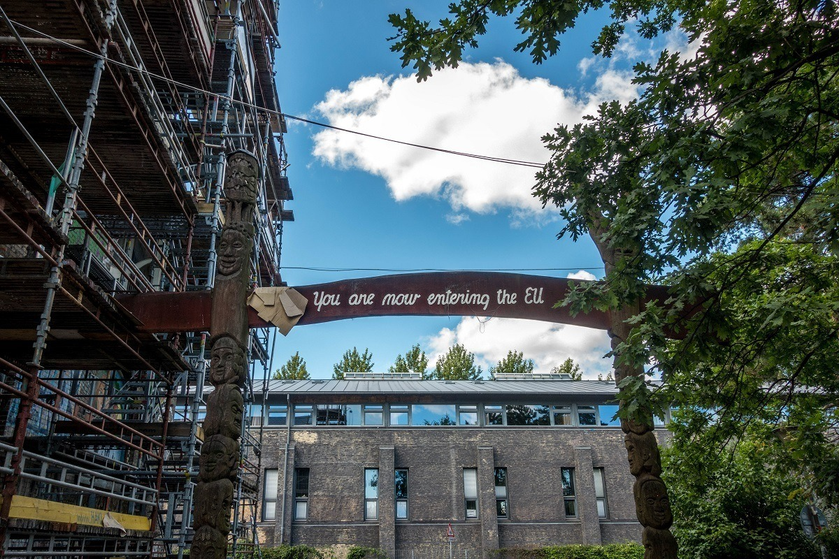 """The exit sign for Christiania Denmark: """"you are now entering the EU"""""""
