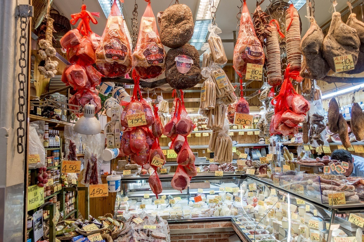 Lots of cured meat and cheese items are available at Mercato delle Erbe in Bologna, Italy