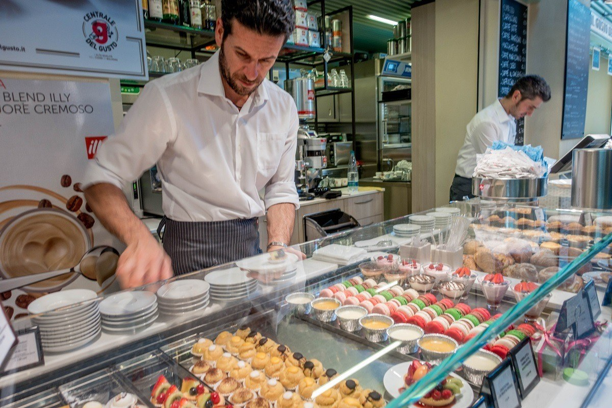 People serving pastries