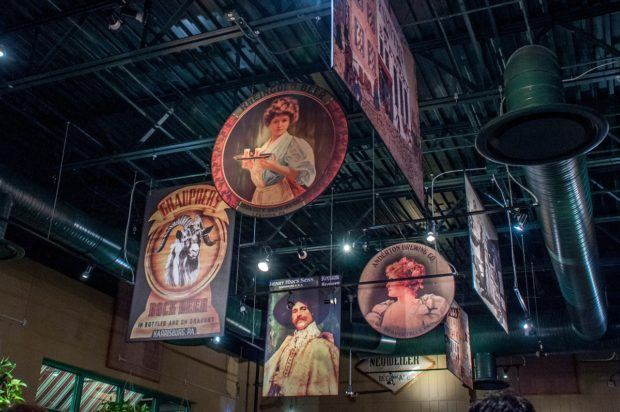 Posters showing the history of brewing in Pennsylvania hang in Otto's Brewery and Pub in State College