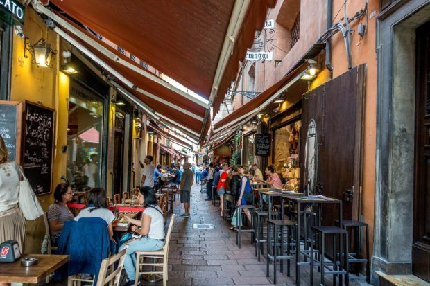 The narrow streets in the center of Bologna, Italy, are home to the Quadrilatero market