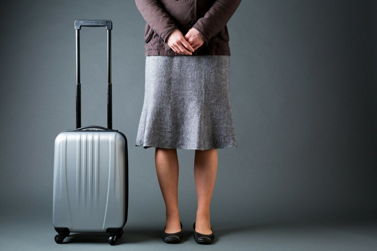 Woman standing next to luggage