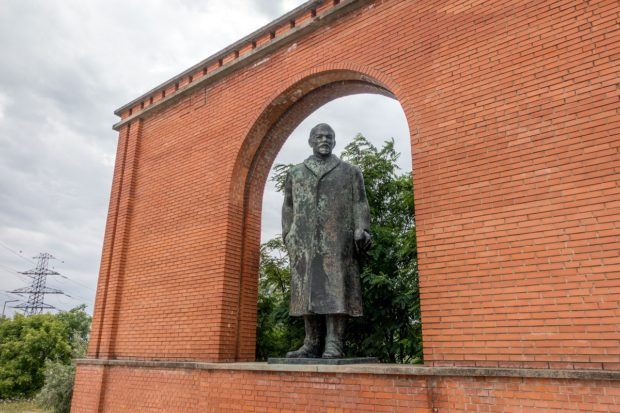 A statue of Vladimir Lenin welcomes visitors to Budapest's Memento Park