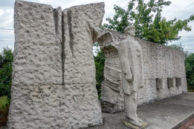 A worker -- quite literally -- breaking through a wall of oppression at Budapest's Memento Park