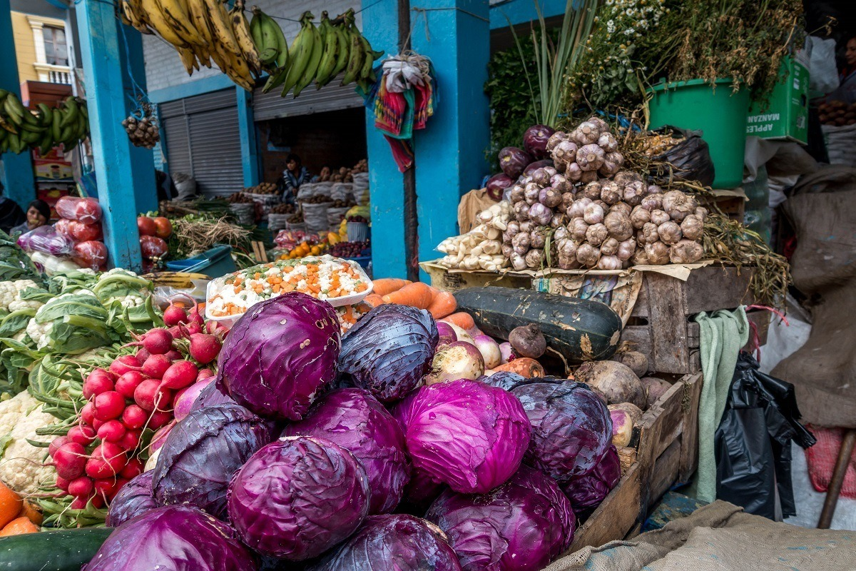 Piles of cabbage and radishes at the Otavalo market, a great stop on any Ecuador itinerary.