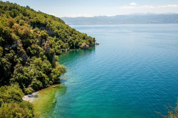 A small cove on Lake Ohrid Macedonia.  Ohrid is known to have the best Macedonia beaches, or really the only beaches in Macedonia. Park yourself on a Macedonia beach and enjoy your Ohrid travel experience!