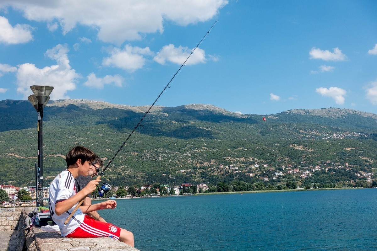 Fishing from the promenade in Lake Ohrid Macedonia.