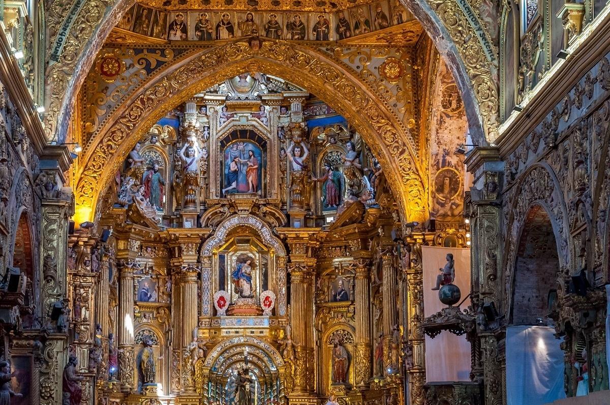 Ornate, gold nterior of the Church of San Francisco in Quito, Ecuador