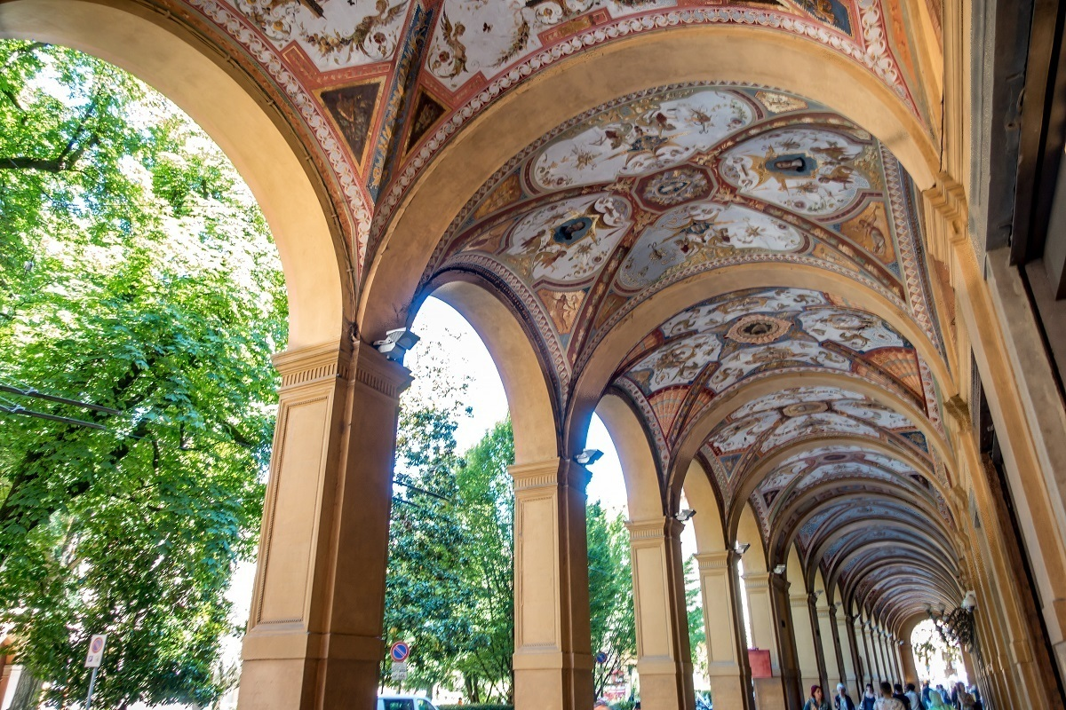 Strolling under the beautiful porticoes is one of the things to do when you visit Bologna, Italy