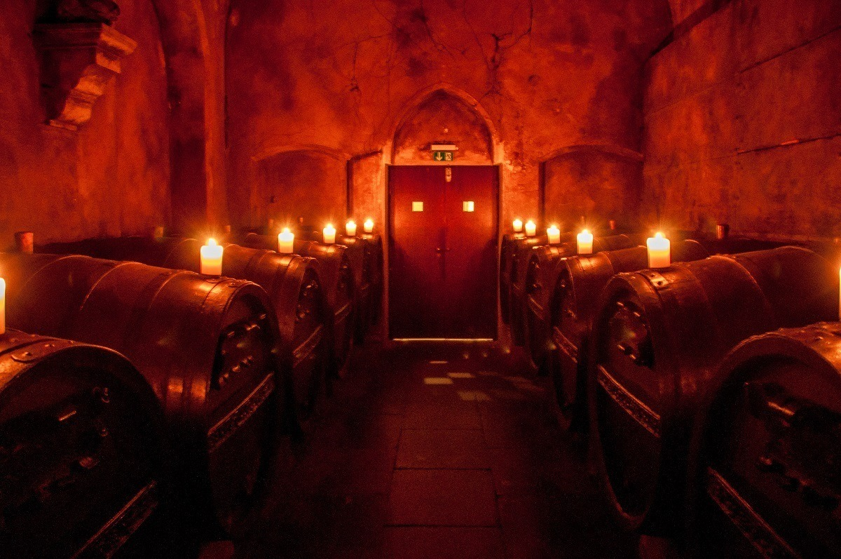 Wine barrels illuminated with candles