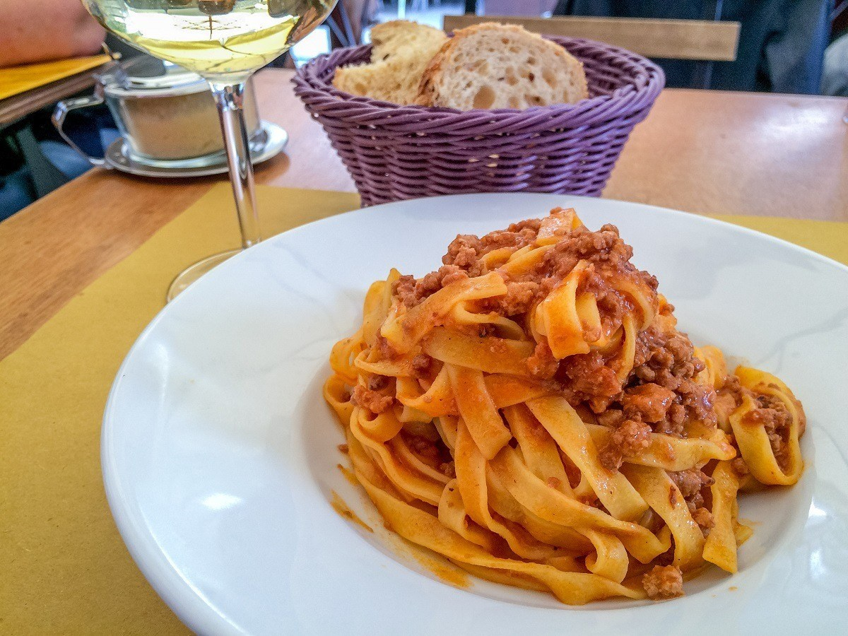 Tagliatelle al ragu is one of the traditional foods to try in Bologna. Sampling regional specialties is one of the best things to do in Italy.