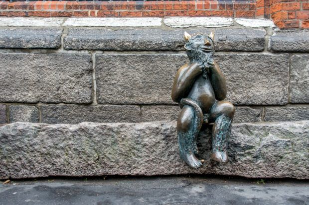 In the Hanseatic city of Lubeck, Germany, the Devil waits patiently for patrons leaving the wine bar near St. Mary's Church