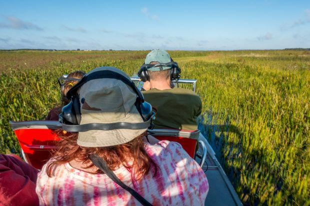 On a Spirit of the Swamp airboat tour, visitors wear headsets for noise protection and to allow for communication with the captain