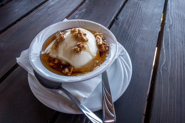Yogurt with honey and walnuts was one of our favorite foods in Albania. It  served as both an Albanian breakfast and snack.