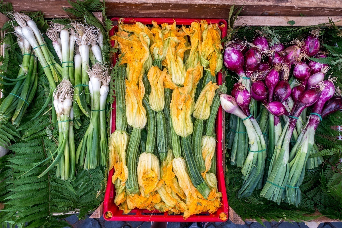 Some of the beautiful summer vegetables for sale at the Campo de Fiori market in Rome, Italy