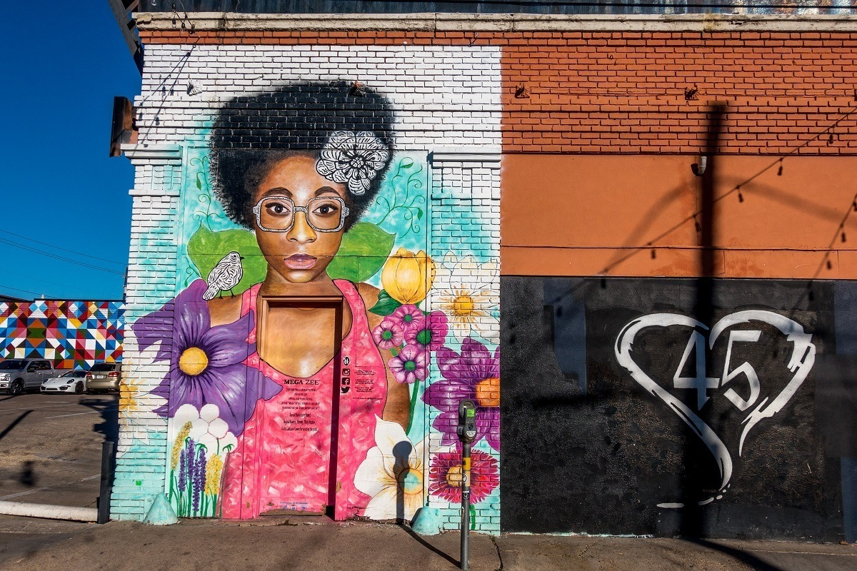 Street art mural of a woman with flowers