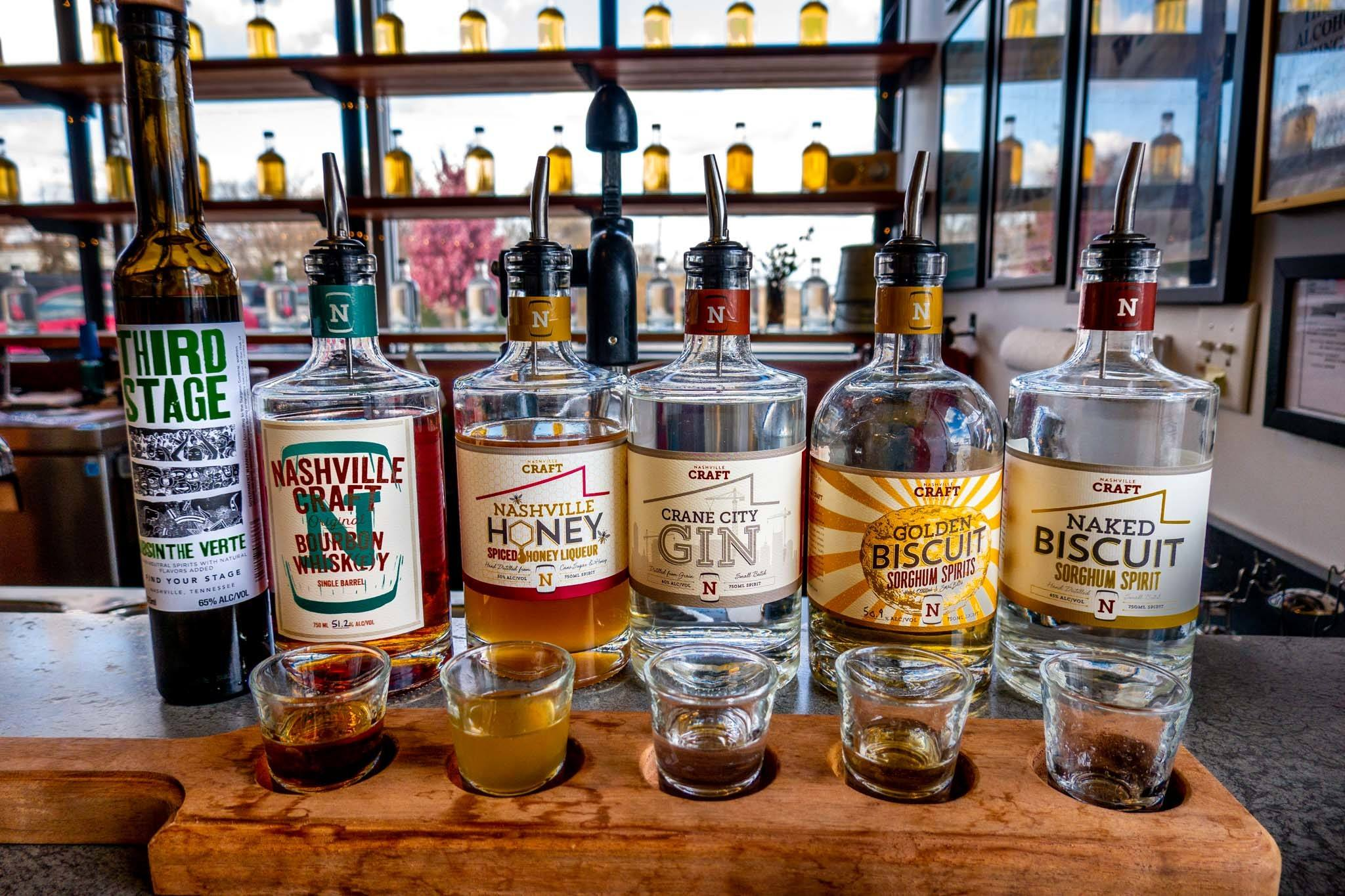 Bottles of spirits and shot glasses on the bar at Nashville Craft Distillery