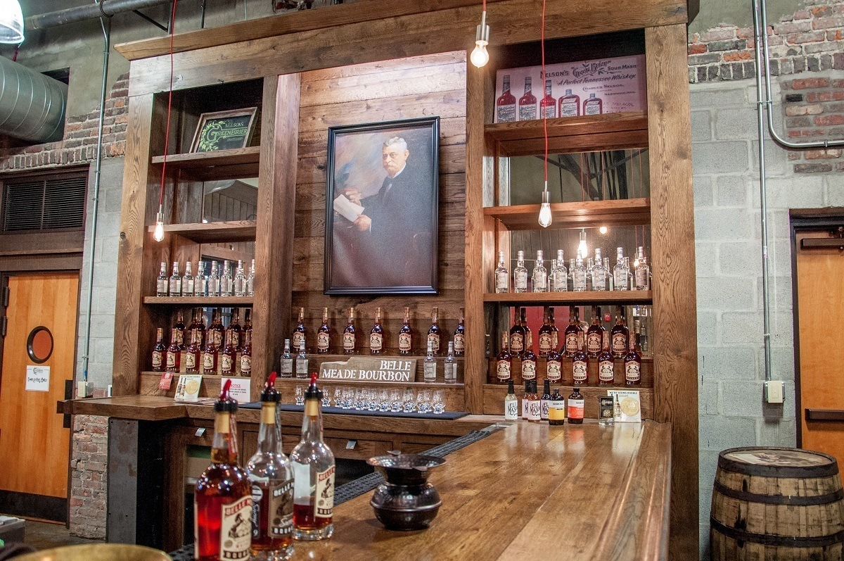 Tasting room bar at Nelson's Green Brier Distillery along with a portrait of Charles Nelson