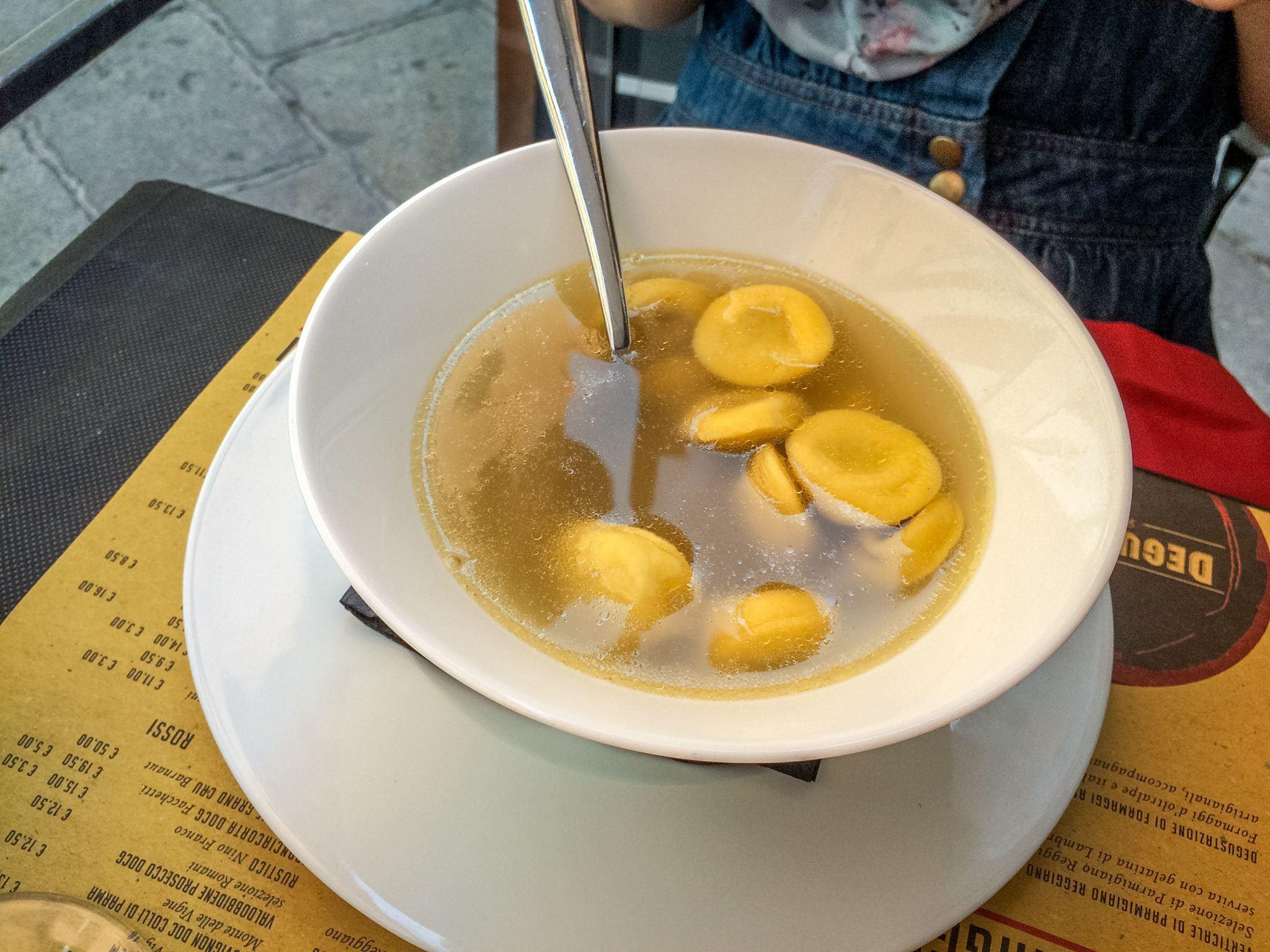 Anolini in brodo, pasta floating in broth