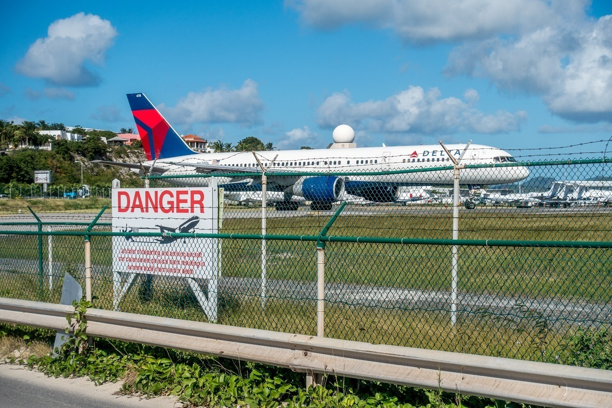 Plane behind a sign about the dangers of being too close