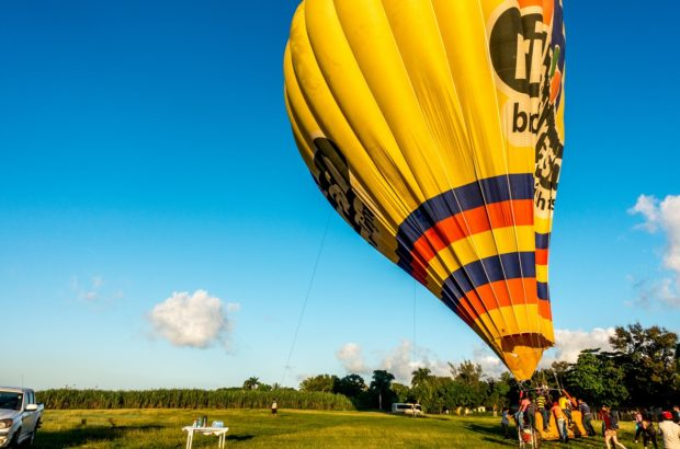 Taking off in a hot air balloon over Punta Cana, Dominican Republic.