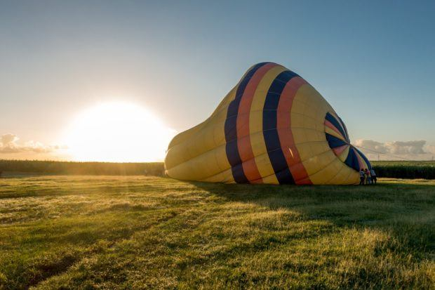 Inflating a hot air balloon at sunrise in Punta Cana, Dominican Republic
