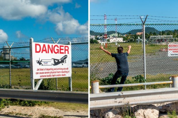 Warning signs about not fence surfing at Princess Juliana International Airport in St. Maarten