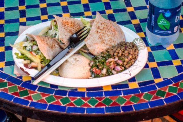 Hummus, pita, and other great choices in the Morocco pavilion at Epcot. It's important to stop for a few bites along the way on an Epcot drink around the world tour.