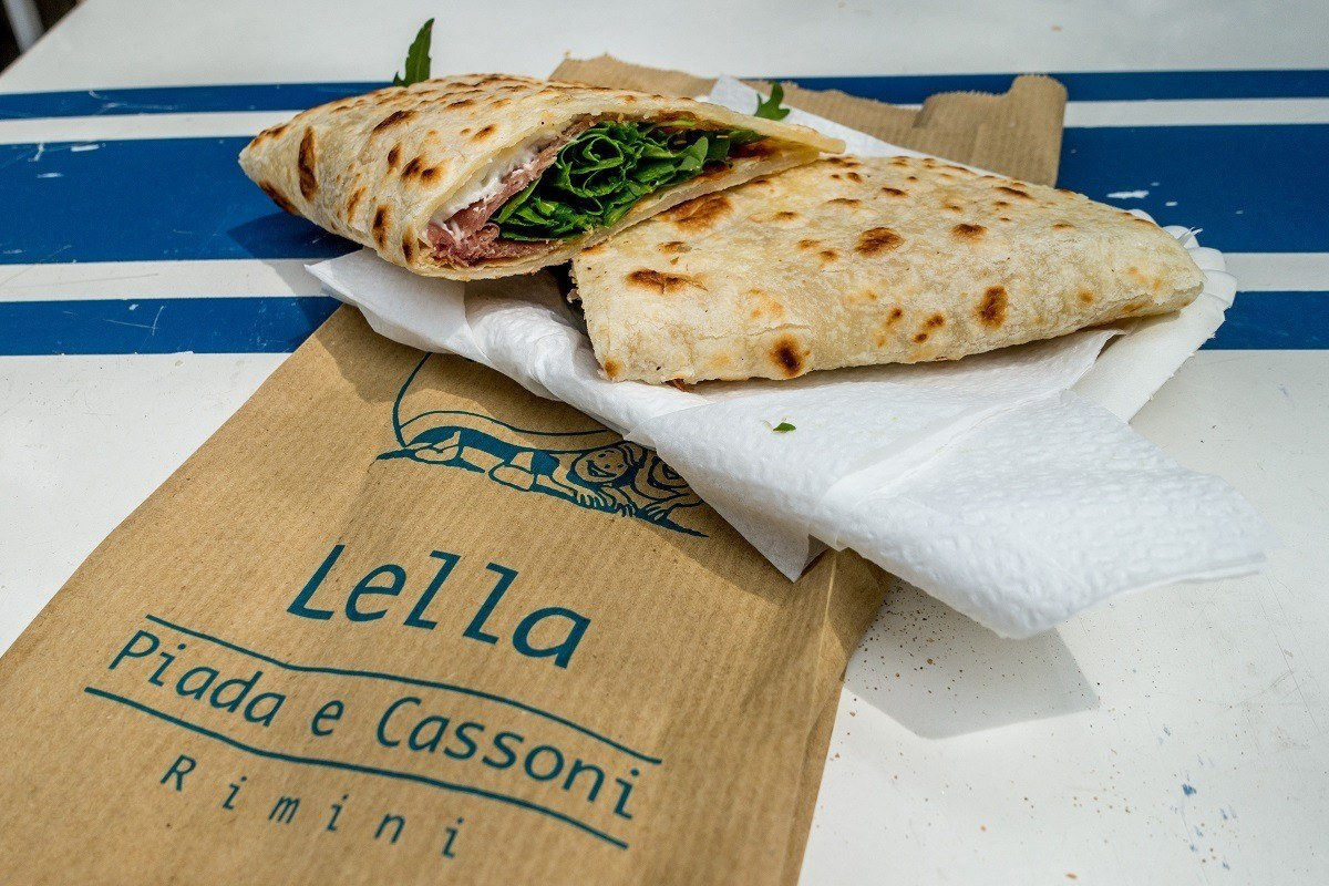 A piadina stuffed with cheese, meat, and vegetables