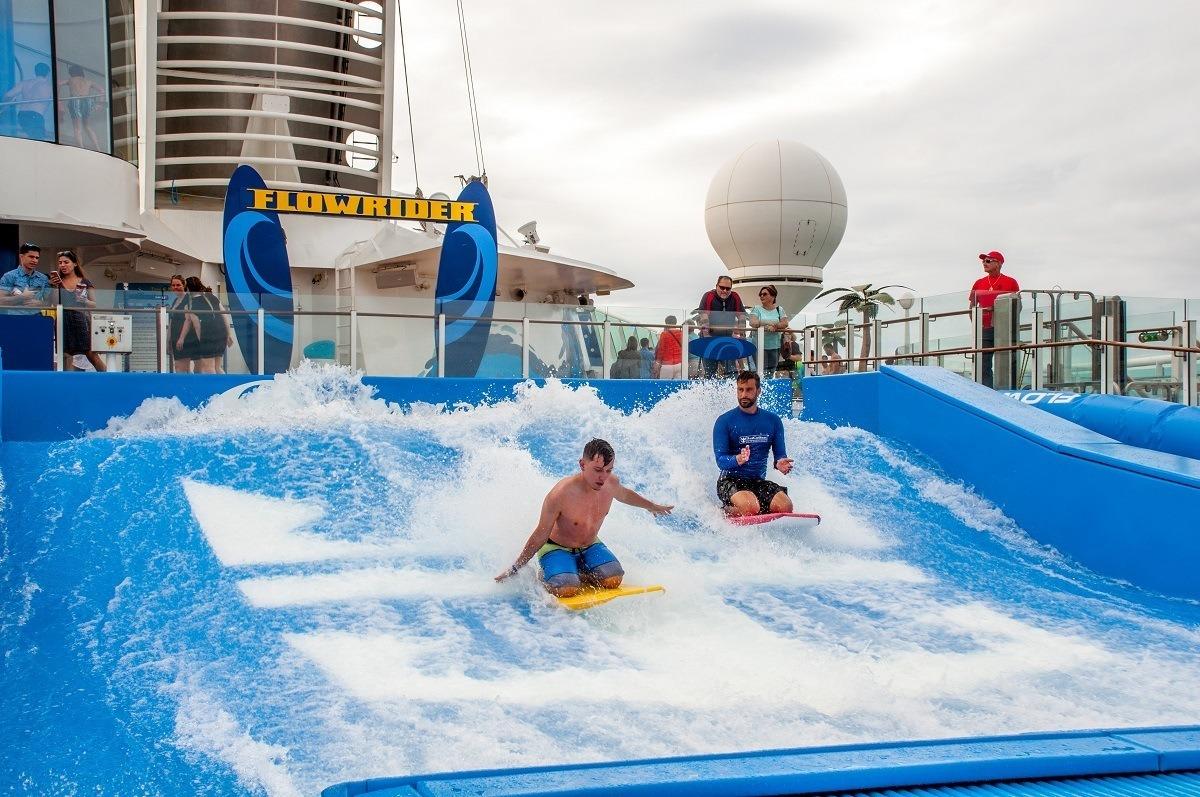 Boy using a Flowrider on a Royal Caribbean cruise