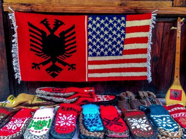 Albanian and American flags woven together in an Albania bazaar