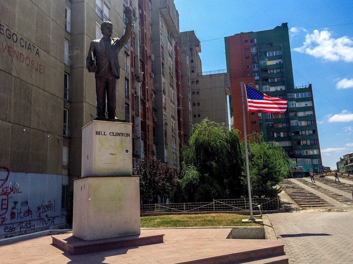 Bill Clinton statue and American flag in Pristina, Kosovo