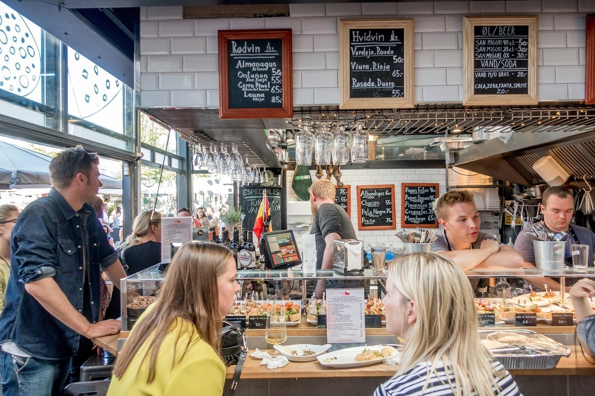 People eating tapas at a great food market in Copenhagen