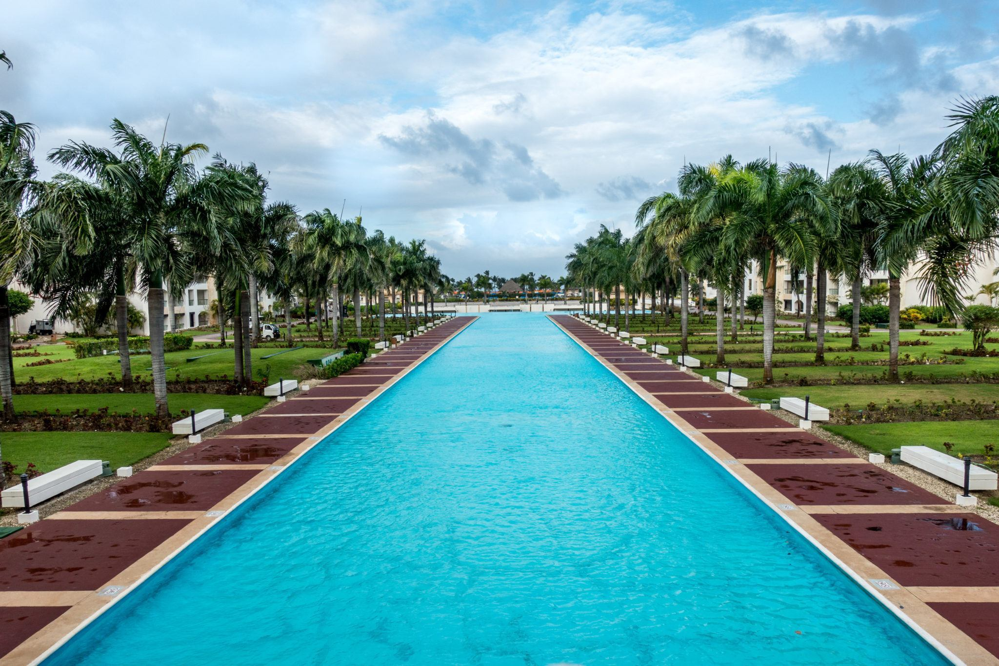 Pool lined with palm trees in Punta Cana Dominican Republic