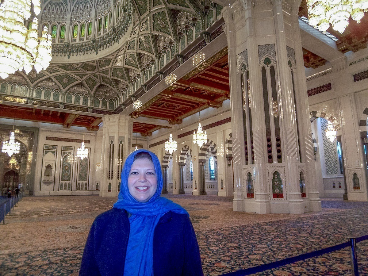 Laura inside Sultan Qaboos Grand Mosque