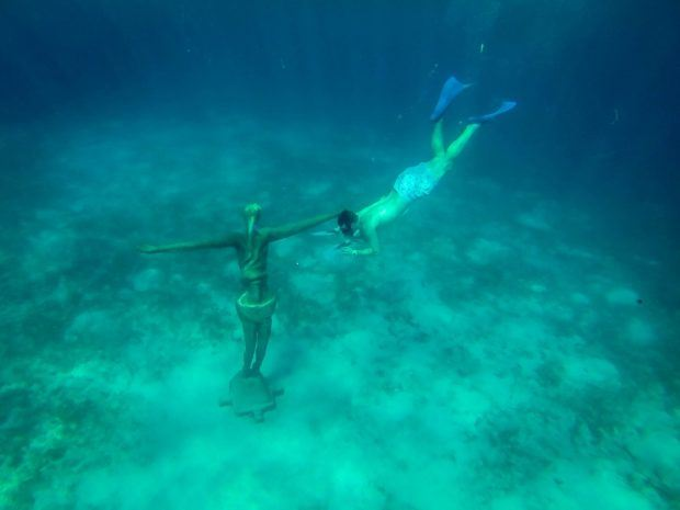 The best snorkel gear will let you see interesting things like statues underwater easily and safely.