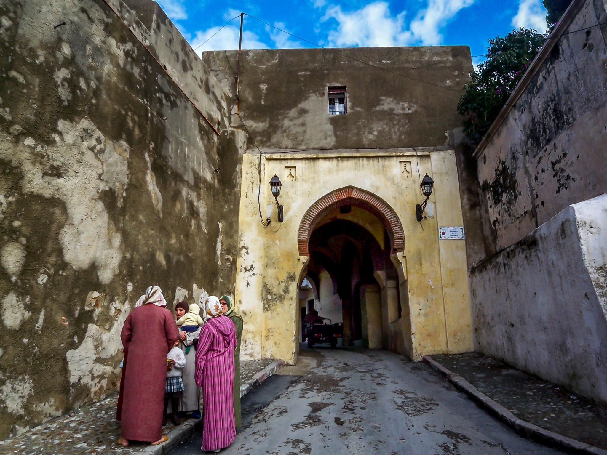 Woman and children by gate in Tangier, Morocco