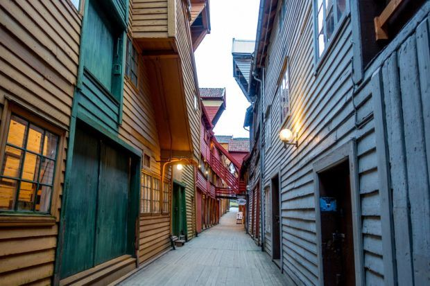 Bryggen is home to a series of workshops and stores and is a highlight of a Bergen sightseeing tour
